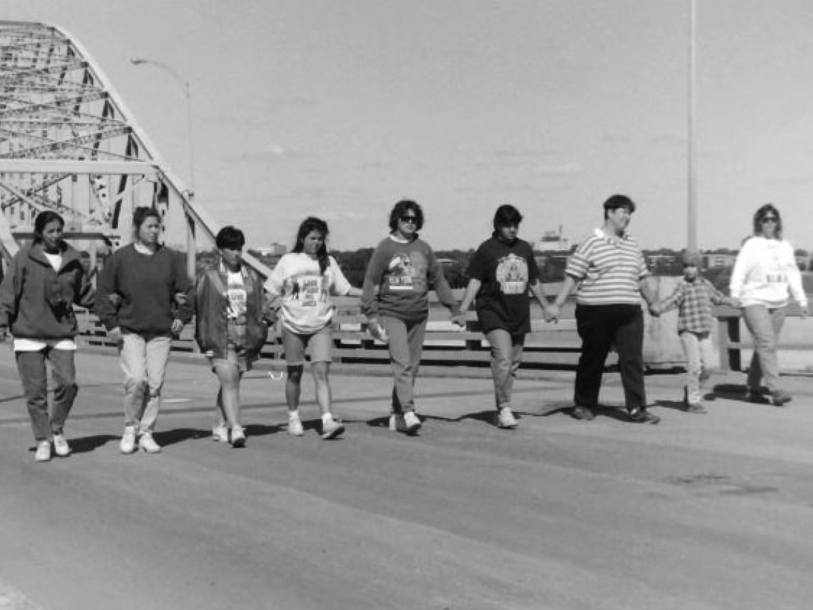 july 1990: mohawks walk on the mercier bridge, which connects montreal to kahnawake, hours. kahnawake mohawks blocked the bridge as soon as they learned of the police raid in their